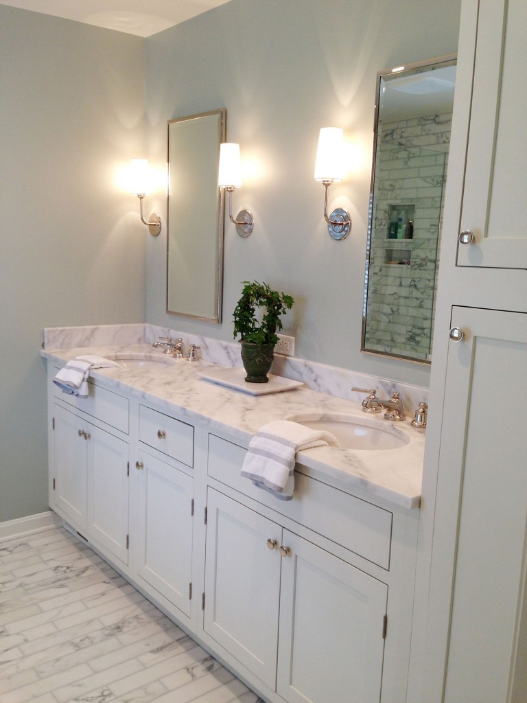Photo gallery of remodeled bath features CliqStudios Austin Painted White cabinets