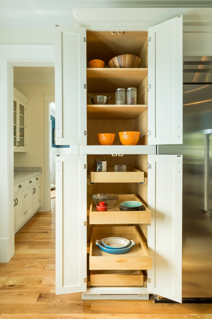 Kitchen remodeling project features CliqStudios.com inset cabinets in the Austin cabinet style in a painted White finish. Features include this built-in tall pantry cabinet with slide-out shelves for easy-reach storage and organization.