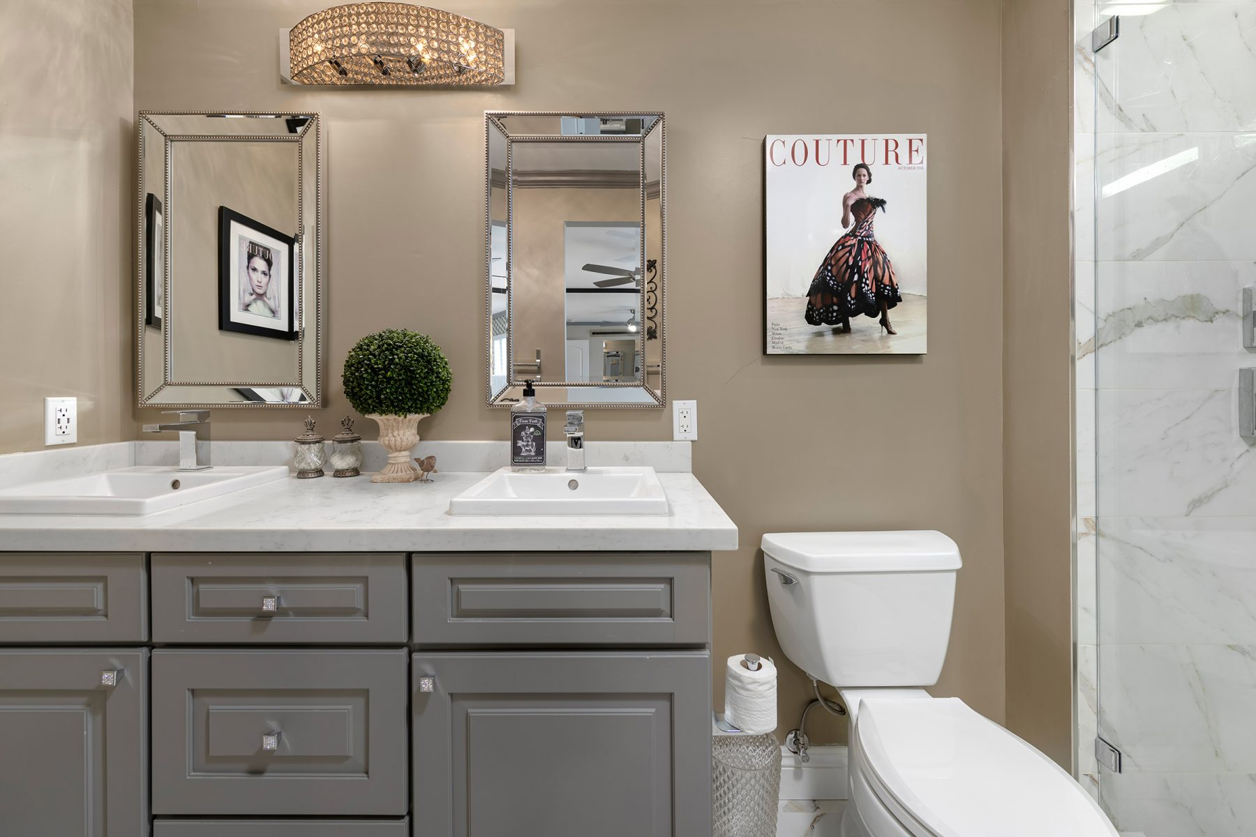 CliqStudios bath cabinets shown in Cambridge Studio Gray door style and finish