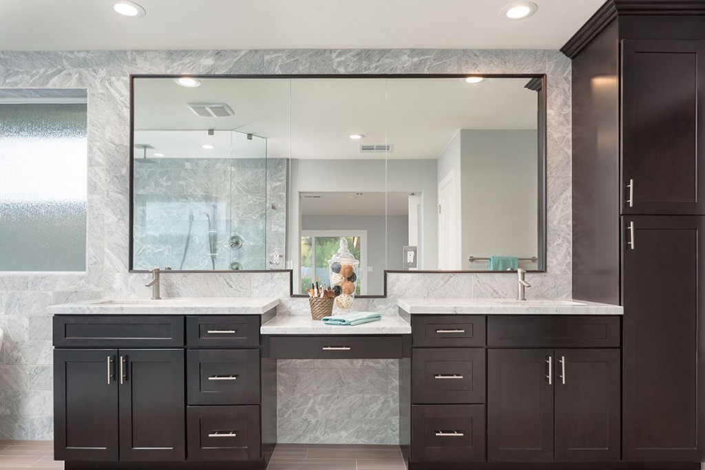 Bath remodeling project features shaker-style cabinetry by CliqStudios.com, shown in Dayton style in Birch Sable finish.